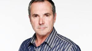 Alan Fletcher as Dr Karl Kennedy on Neighbours.